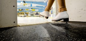 Skates on rink matting